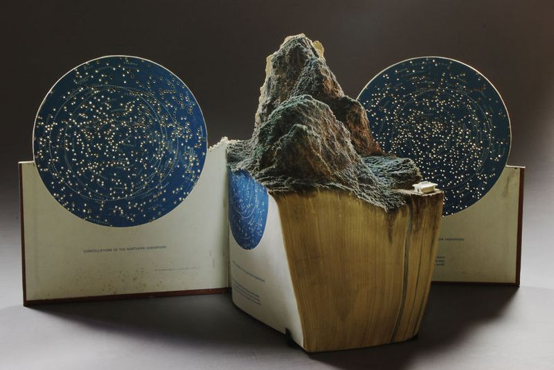 Mountain Carved From The Pages Of An Old Star Map Book