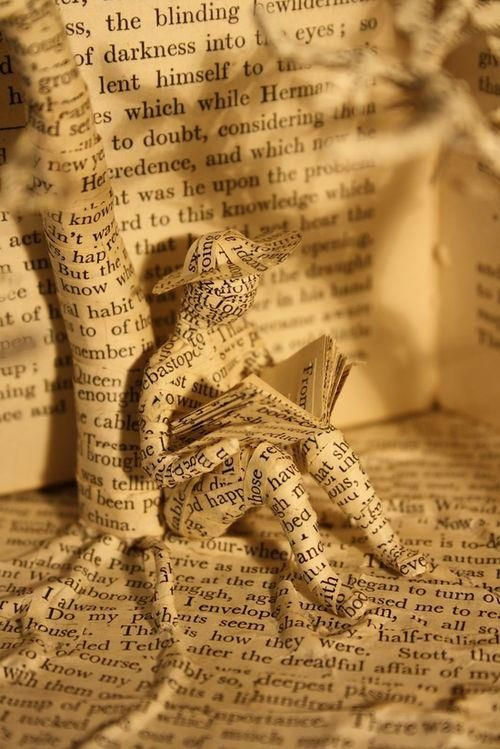 Book sculpture man reading under a tree
