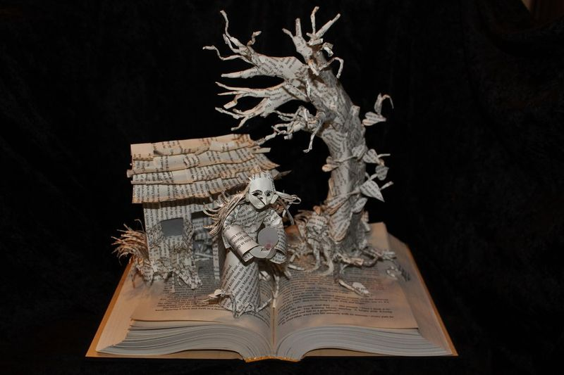 Wizard_and_glass_book_sculpture_unlit_by_wetcanvas-d6j3srg