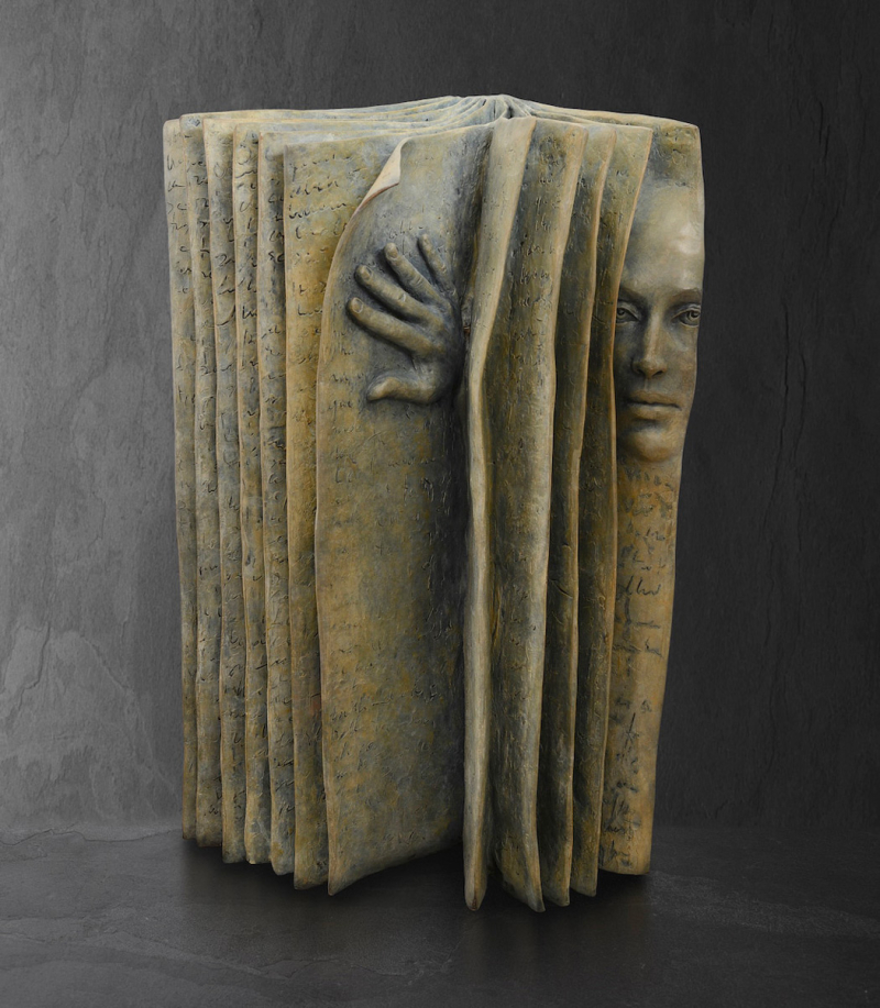 Pensive Faces Peer Out From the Pages of Bronze Book Sculptures by Paola Grizi 2